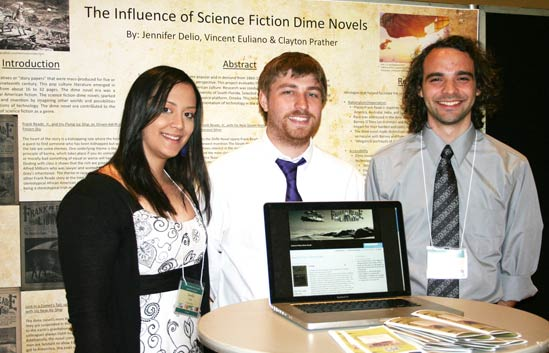 Jennifer Delio, Clayton Prather and Vincent Euliano present their research on Science Fiction in Dime Novels at the USF Office for Undergraduate Research Colloquium